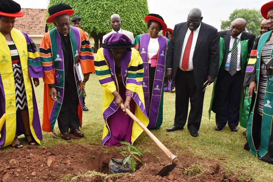 Hon Mary Karoro Okurut, Minister of General Duties, Office of the Prime Minister plants a tree during the graduation event at MIHS